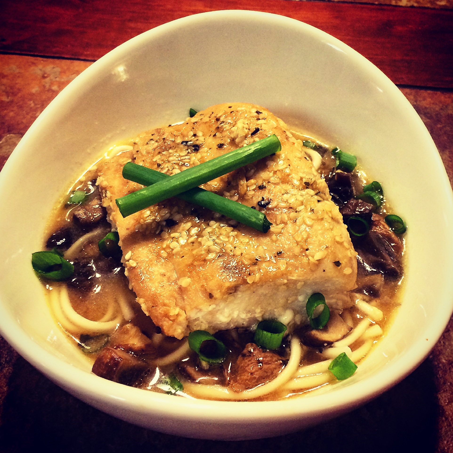 Sesame Encrusted Mahi Mahi over Mushroom Miso Broth with Udon Noodles
