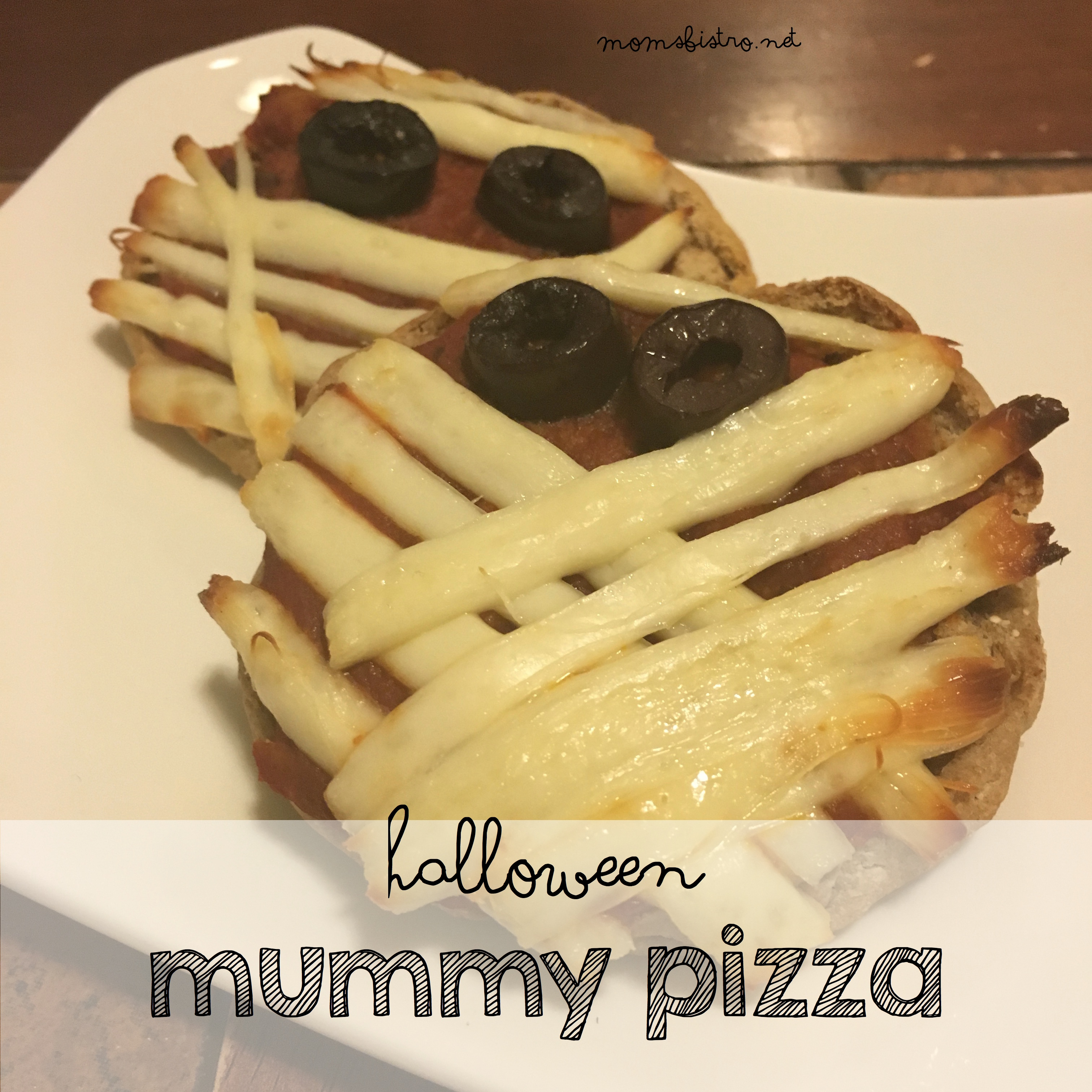 A Halloween Dinner You Can Make In Only 15 Minutes!  Make These Mini Mummy Pizzas With Your Kids This Halloween | Halloween English Muffin Mummy Pizza Recipe