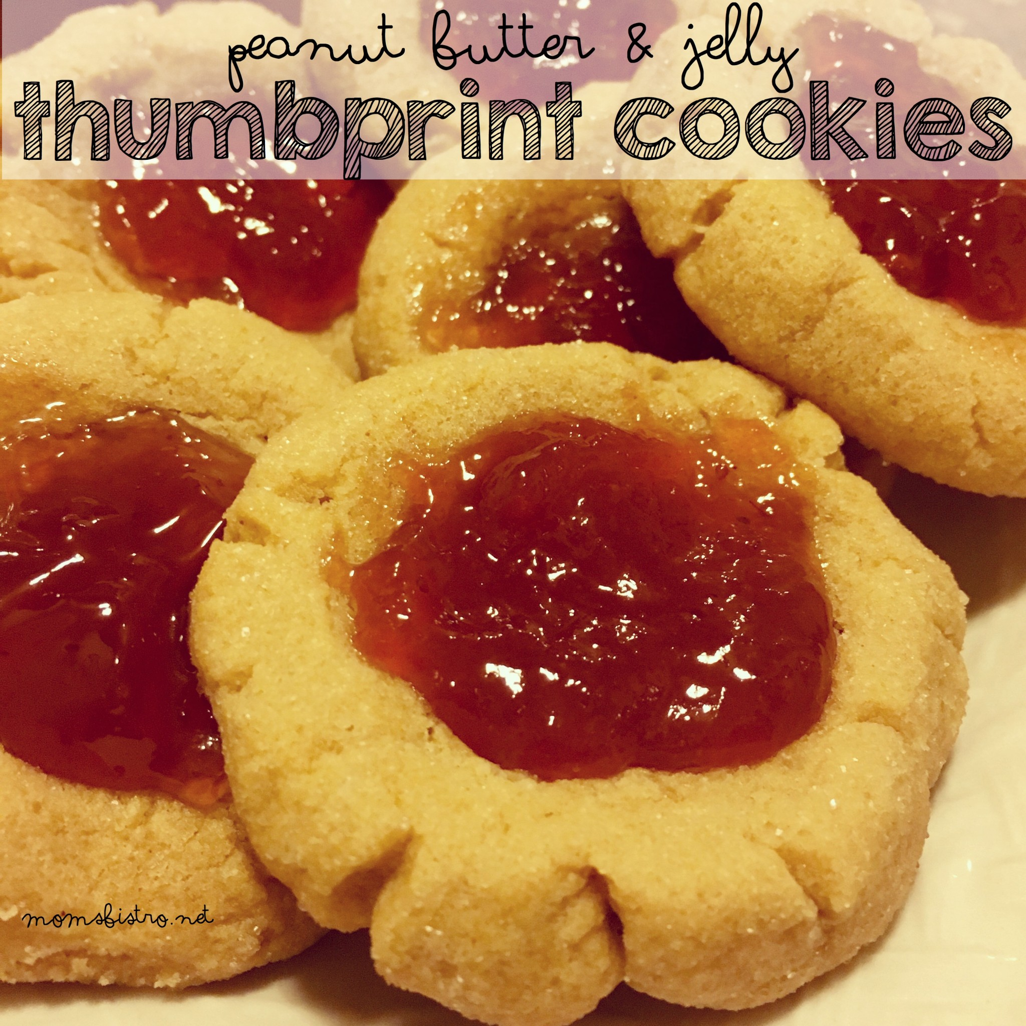Get Ready For National Peanut Butter Day!  Celebrate Tomorrow with Peanut Butter and Jelly Thumbprint Cookies